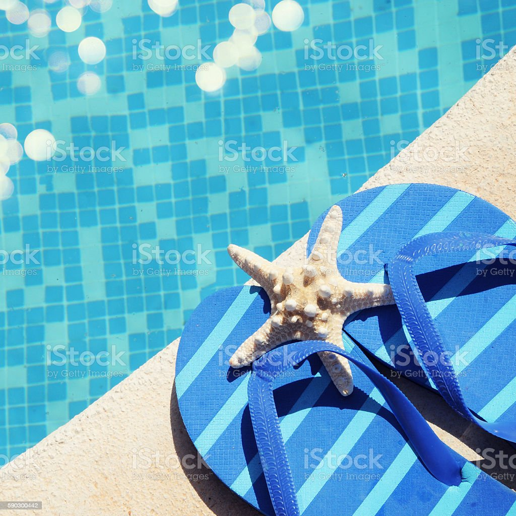 flip flops by the swimming pool royaltyfri bildbanksbilder