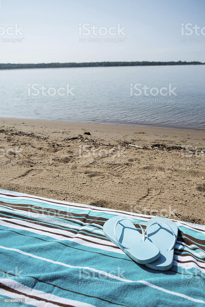 Flip Flops on Blue Beach Towel Lake Michigan Shore stock photo