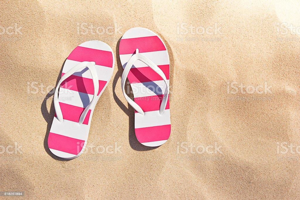 flip flops on the beach stock photo