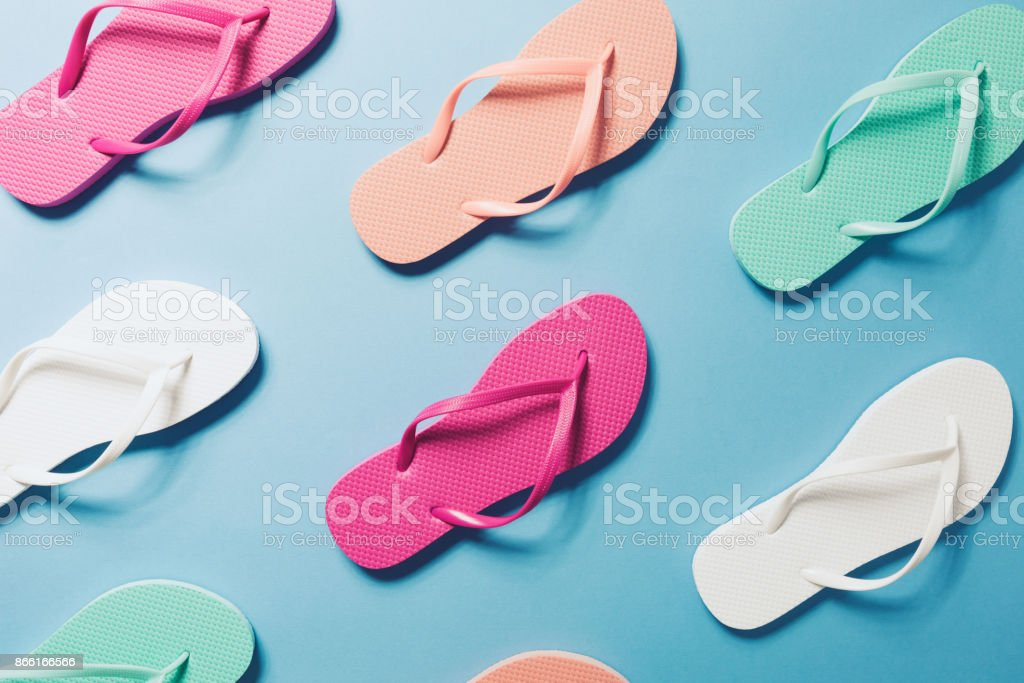 Flip flops on the blue background stock photo