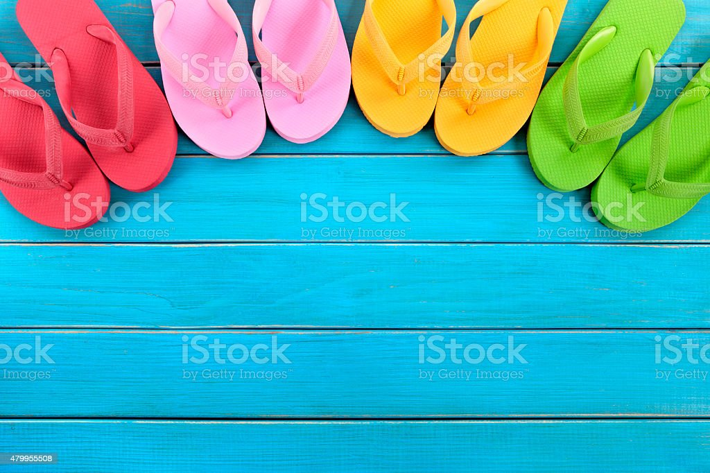 Flip flops with blue decking stock photo