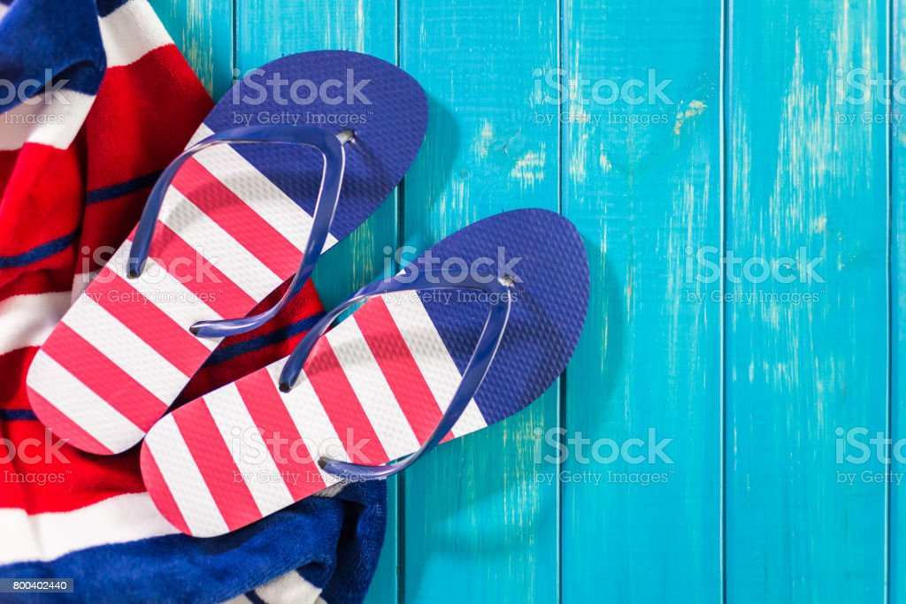 Flip flops with red white and blue pattern with July 4th theme. stock photo