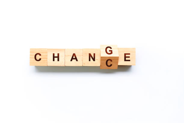 Flip wooden cube with word CHANGE to CHANCE stock photo