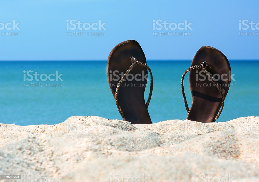 Flip-flop on sea background royalty-free stock photo