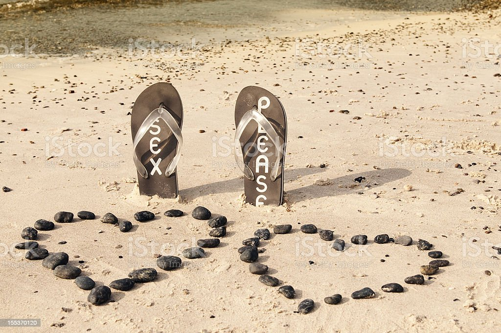 Flip-flop on the Sand royalty-free stock photo