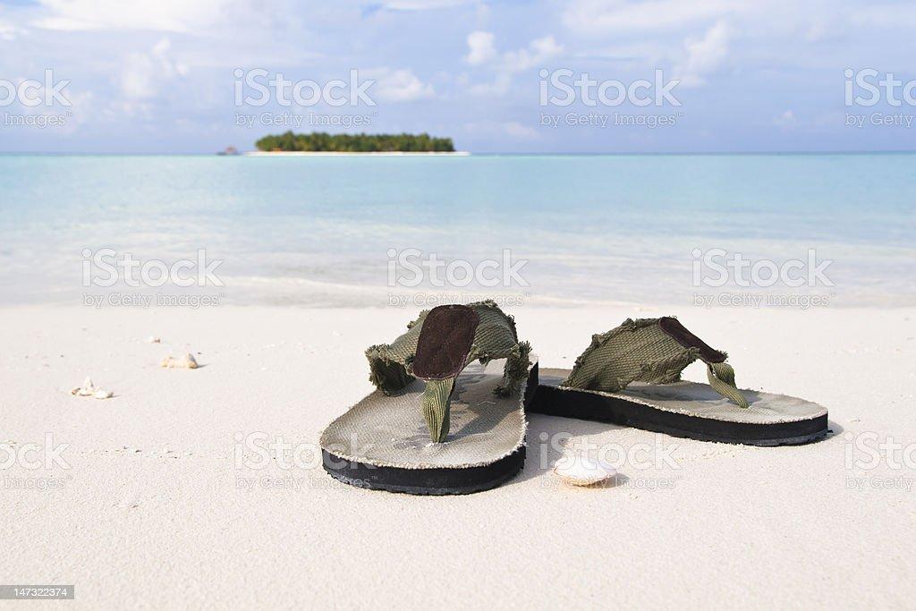 Flip-flop on white sand beach royalty-free stock photo