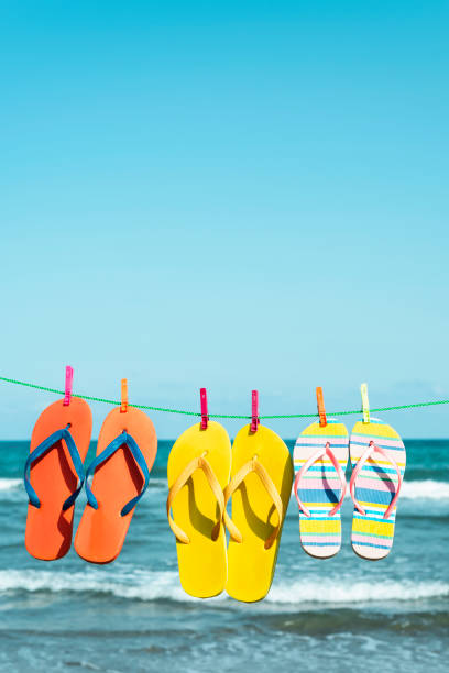 flip-flops hanging on a clothes line stock photo