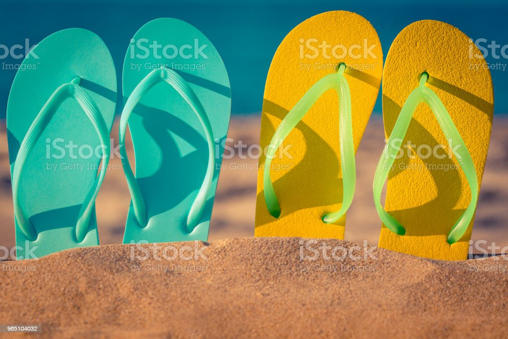 Flip-flops on the sand royalty-free stock photo