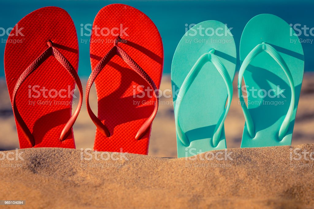Flip-flops on the sand zbiór zdjęć royalty-free