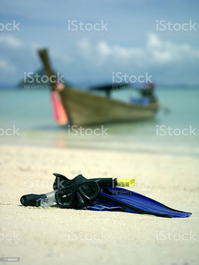 Flippers on a sandy beach royalty-free stock photo
