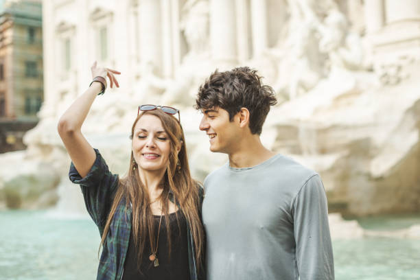 flipping a coin in trevi fountain - throw money away stock pictures, royalty-free photos & images