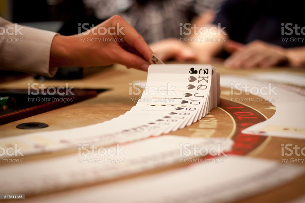 Flipping cards in casino stock photo