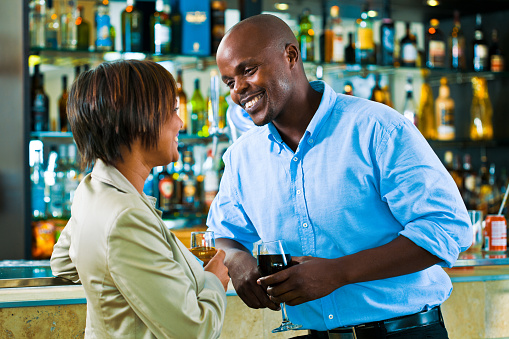 Flirt In The Pub Stock Photo - Download Image Now