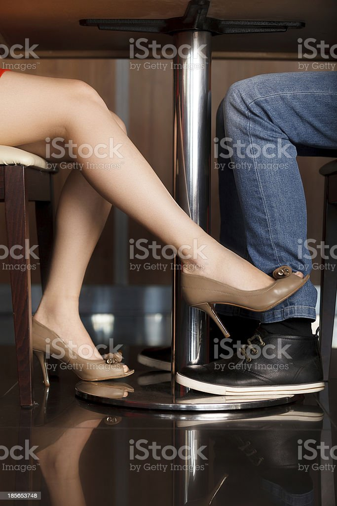 Royalty Free Feet Under Table Pictures Images and Stock Photos iStock