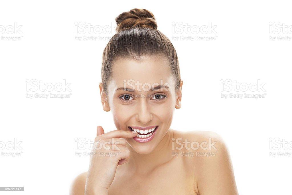 Flirtatious Woman Biting Her Nail Stock Photo & More