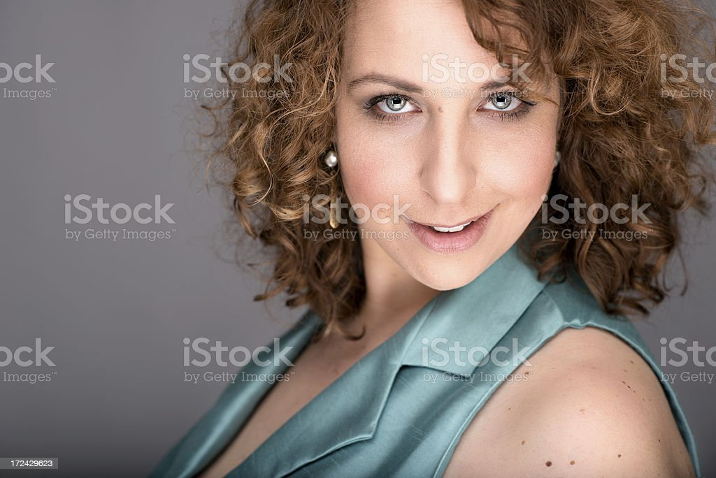 Flirtatious Young Woman on Gray Background royalty-free stock photo