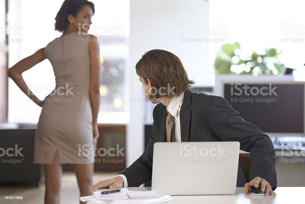 Flirting at the office stock photo