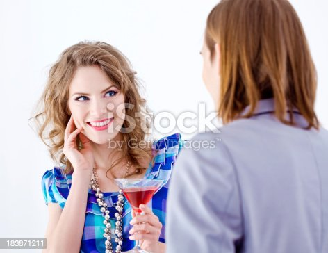 854381780istockphoto Flirting couple 183871211