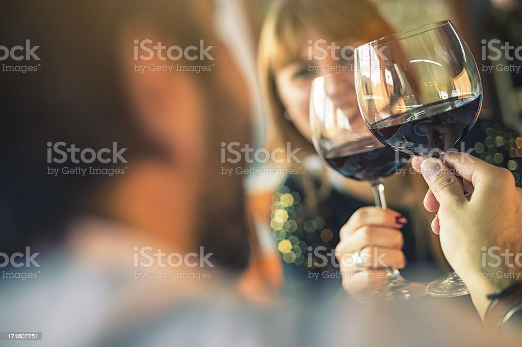 Flirting couple toasting during a date stock photo
