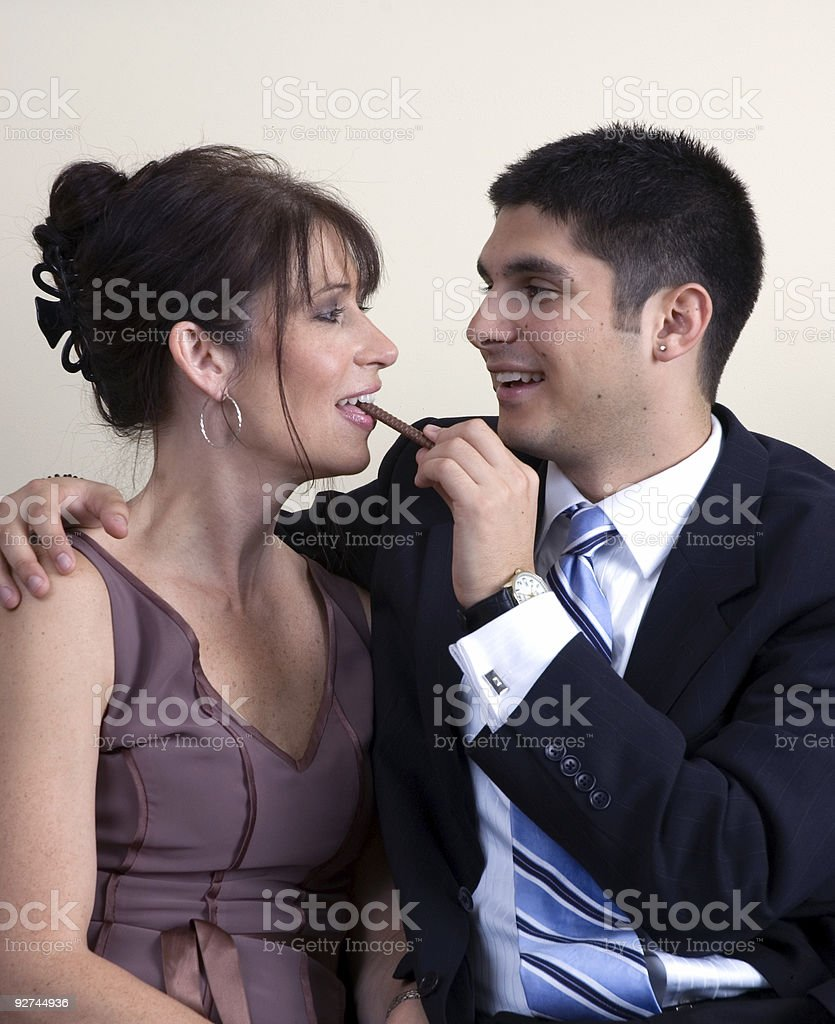Flirting Formal Couple with Chocolate stock photo