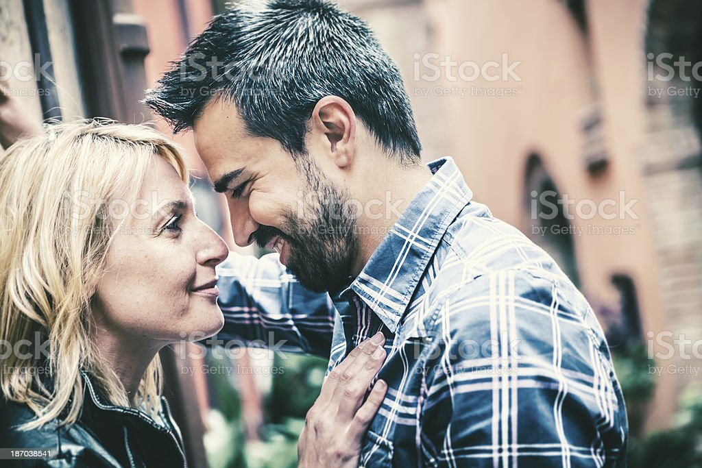 Flirting in an Alley, Italian Mid Adults Couple stock photo