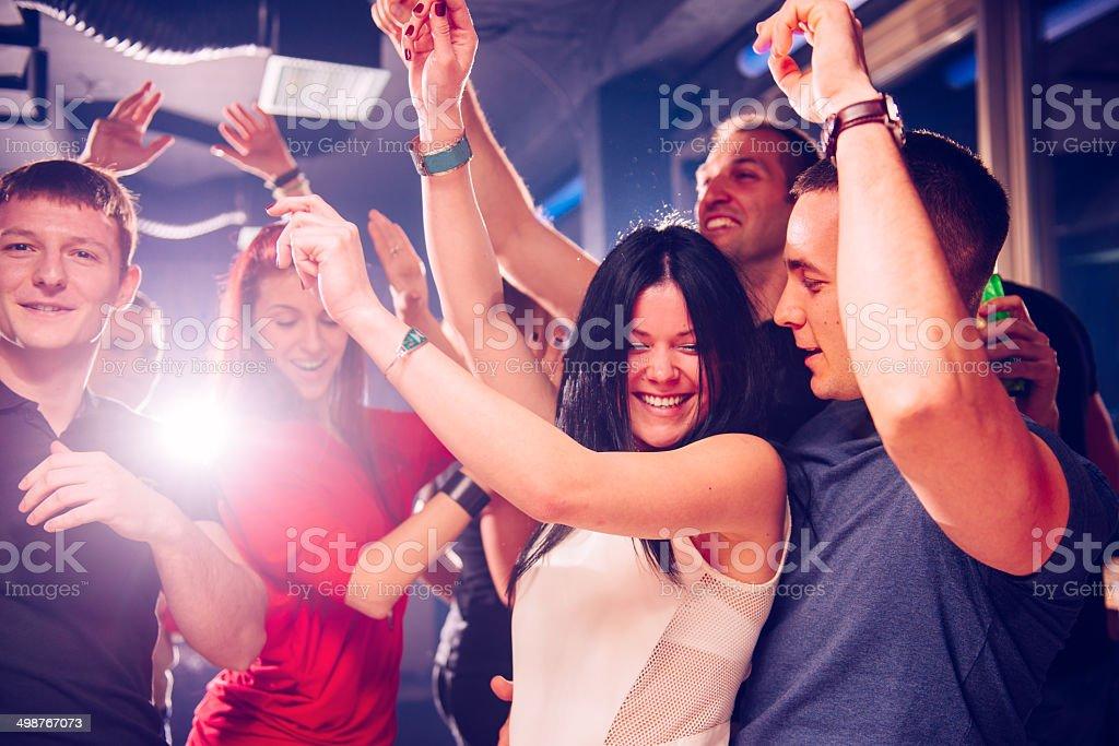 Flirting in club stock photo