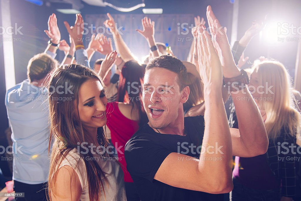 Flirting in club stock photo