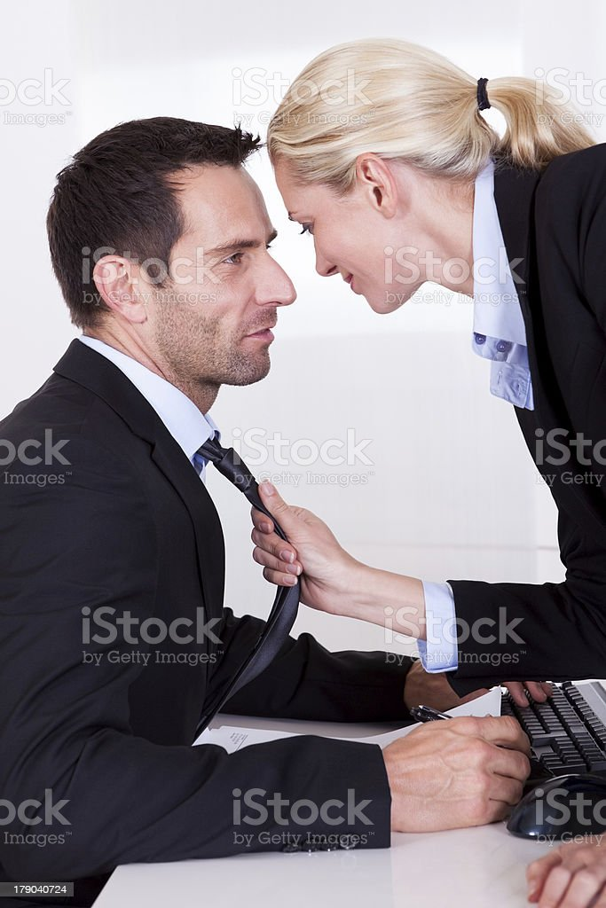 Flirting in the office royalty-free stock photo