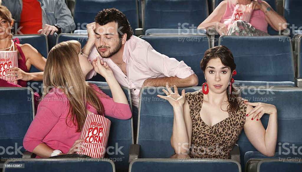 Flirting in The Theater royalty-free stock photo