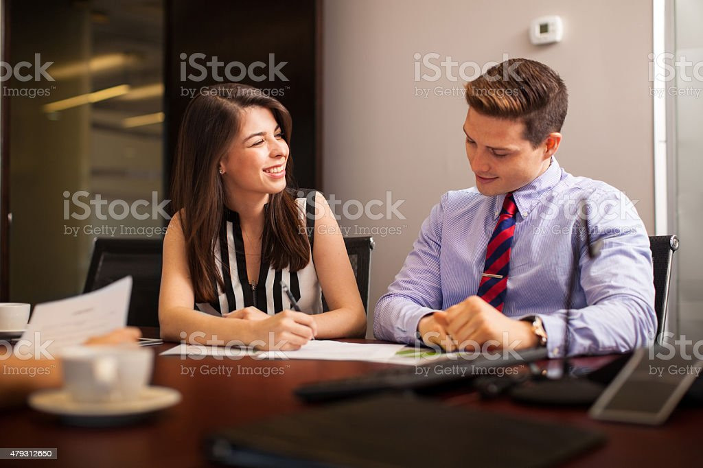 Flirting in the workplace stock photo