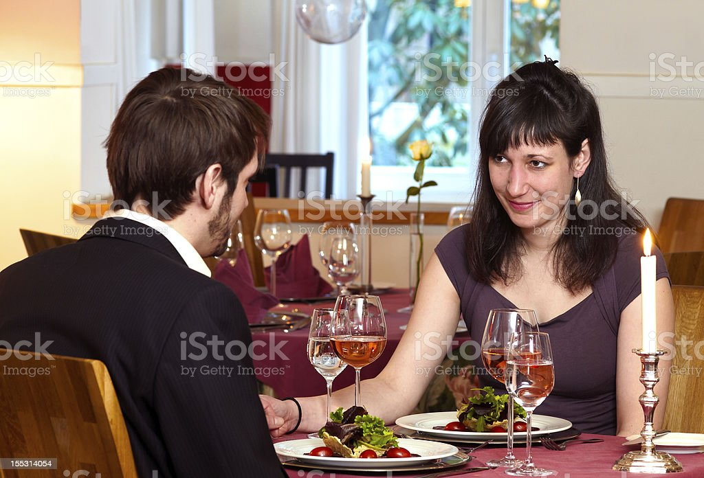 Flirting Over A Romantic Dinner royalty-free stock photo