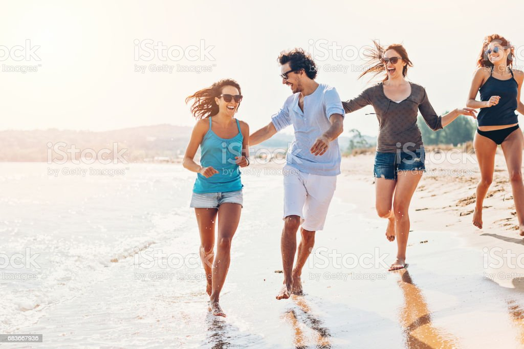 Flirting with the girls on the beach stock photo