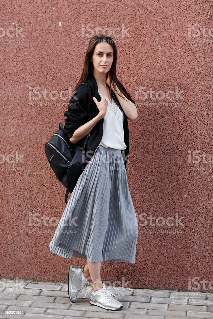 Flirty beautiful brunette young woman with backpack royalty-free stock photo