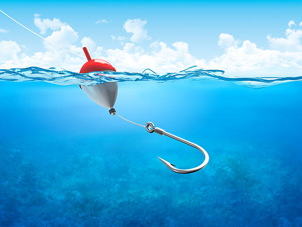 Float, fishing line and hook underwater vertical  fishing hook stock pictures, royalty-free photos & images