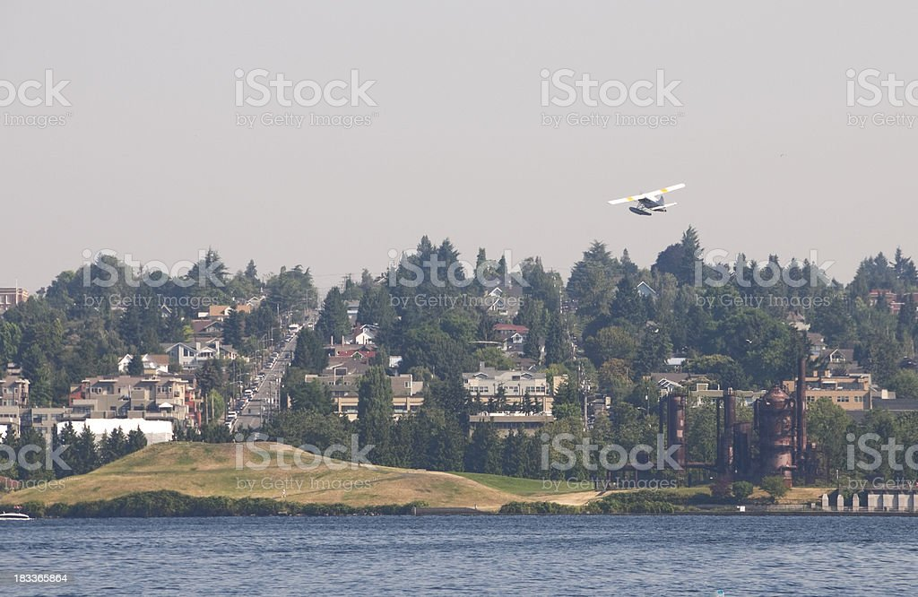Float plane taking off from lake stock photo