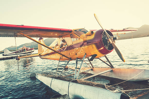 Float Planes in Sunset Float plane dock in Ketchikan, Alaska. ketchikan stock pictures, royalty-free photos & images