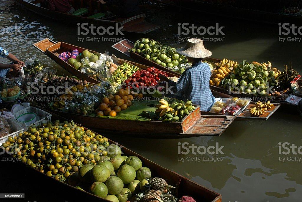 Floating Asian fruit and vegetable market stock photo
