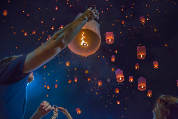 Floating asian lanterns in the sky of Chiang Mai, Thailand Thailand, Asia, Night, Chiang Mai Province, selfie lantern stock pictures, royalty-free photos & images