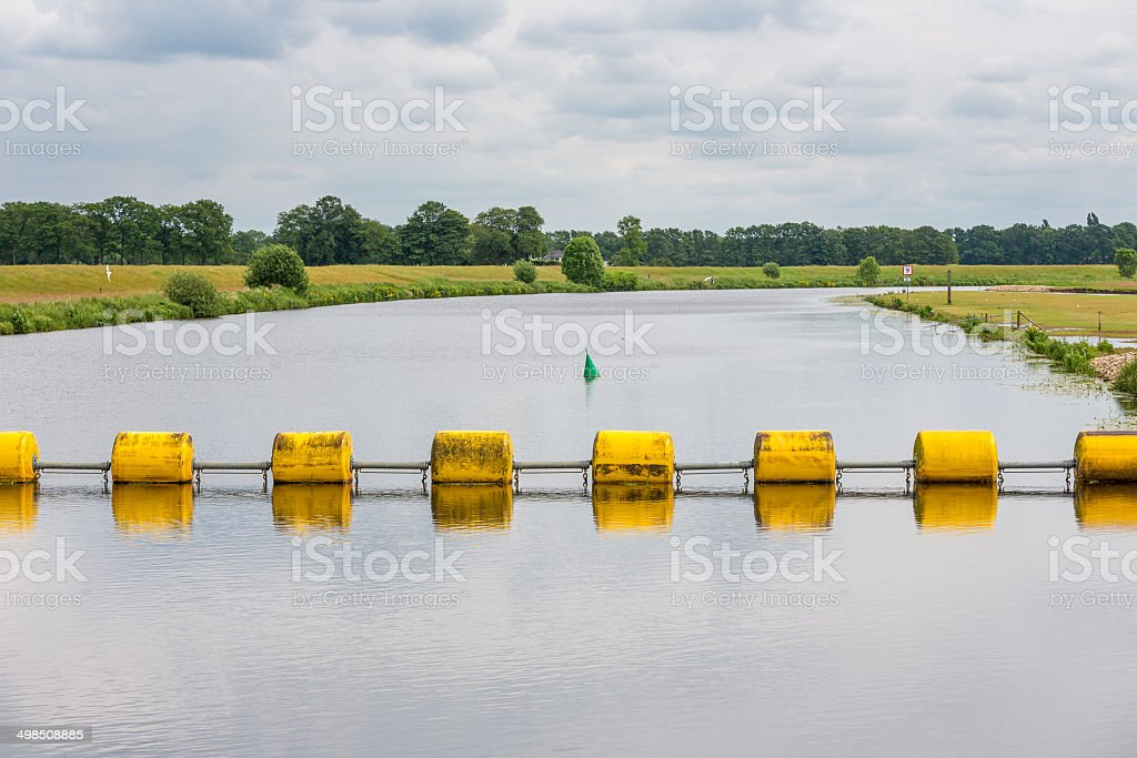 Floating barrage in Dutch river Vecht royalty-free stock photo