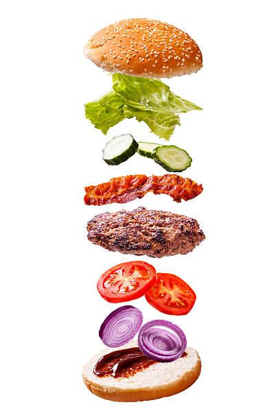 floating beef bacon burger components on white background - gemüselaibchen stock-fotos und bilder