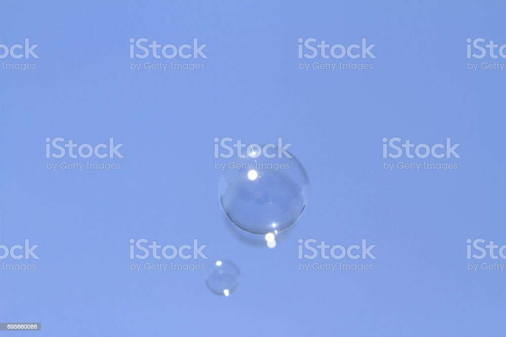 floating bubble soap in the blue sky stock photo