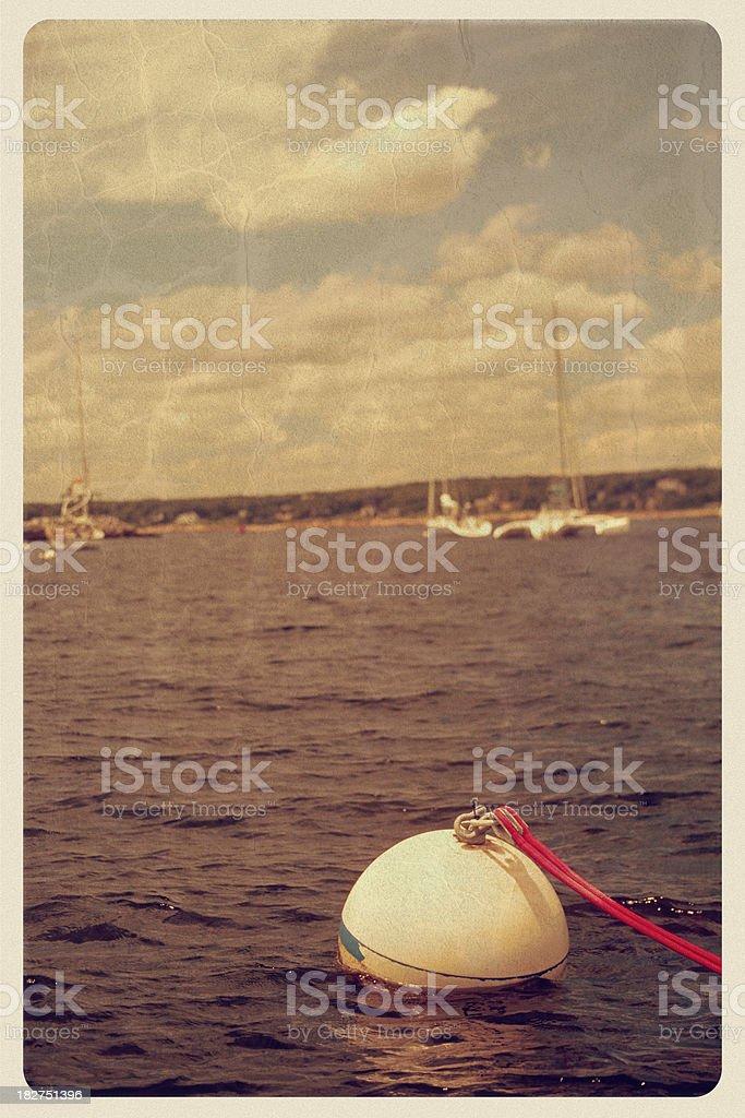 Floating Buoy - Vintage Postcard stock photo
