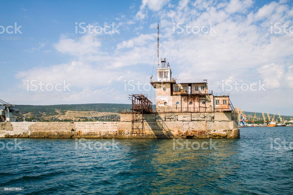 Floating crane and a protective breakwater in Feodosia, Crimea, Russia stock photo