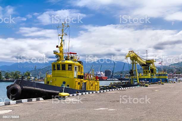 Floating crane and marine tug in the port of Batumi