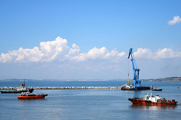 Floating crane and marine tug in the port of Russia stock photo