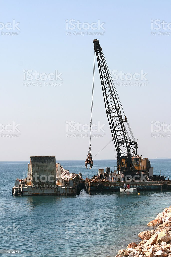 floating crane in action royalty-free stock photo