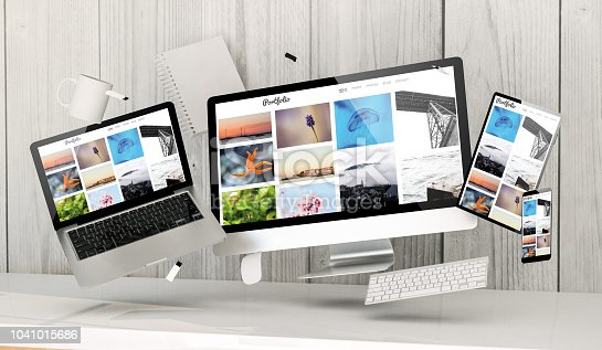 istock floating devices at the office with portfolio on screen 1041015686