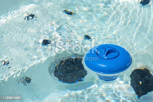 floating diffuser on a water of therapeutic or recreational spa