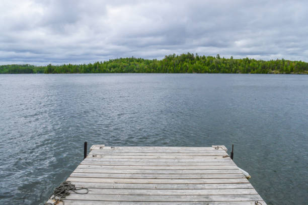 Floating dock on Clearwater Lake in Ontario's Sunset Country stock photo