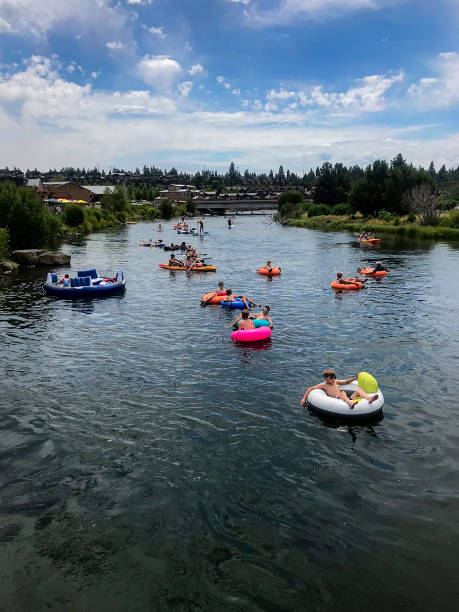 floating down the deschutes river in bend, oregon - bend oregon stock pictures, royalty-free photos & images